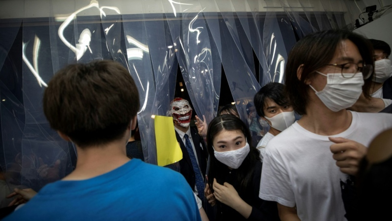 An art exhibit in Tokyo called the Stealable Art Exhibition intended as 'an experiment' attracted nearly 200 people to the streets to raid the gallery after midnight. (AFP)