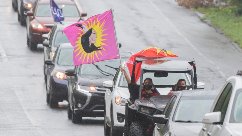 People take part in a convoy to commemorate the thirty year anniversary of the Oka crisis in Oka, Que., Saturday, July 11, 2020. THE CANADIAN PRESS/Graham Hughes