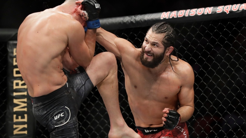 FILE - In this Nov. 3, 2019, file photo, Jorge Masvidal, right, punches Nate Diaz during the second round of a welterweight mixed martial arts bout at UFC 244 in New York. (AP Photo/Frank Franklin II, File)