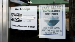 A sign at Tenino Coffee Bistro in Washington state announces the shop accepts the city's wooden money, created to help businesses hit hard by the coronavirus pandemic. (AFP)
