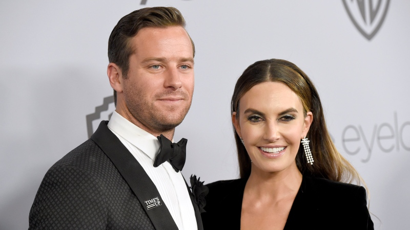 FILE - In this Jan. 7, 2018, file photo, Armie Hammer, left, and Elizabeth Chambers arrive at the InStyle and Warner Bros. Golden Globes afterparty in Beverly Hills, Calif. (Photo by Chris Pizzello/Invision/AP, File)