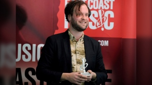 Loel Campbell of Wintersleep accepts the award for FACTOR Recording of the Year at the East Coast Music Awards in Charlottetown, P.E.I., on Sunday, April 17, 2011. THE CANADIAN PRESS/Nathan Rochford