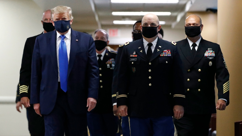 Trump wears face mask to military hospital