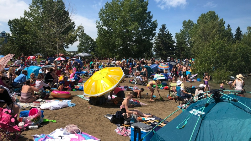 Sun seekers packed a Sylvan Lake beach Saturday. (Courtesy: @papercandie)