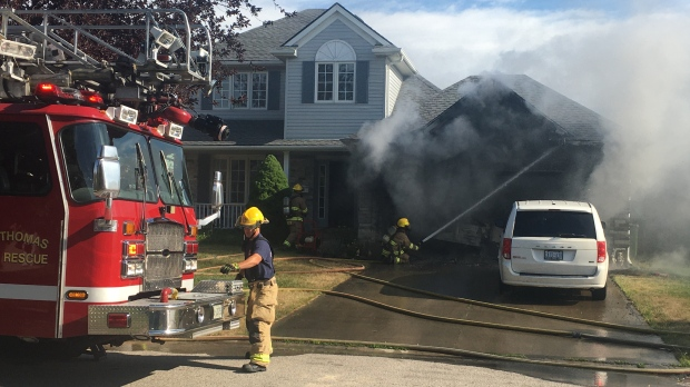 St. Thomas Fire Department arrived at a garage fire at Windemere Place on Sunday, July 12, 2020 (Brent Lale / CTV News)