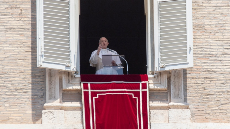 Pope Francis delivers his message after the Angelus noon blessing from the window of his studio overlooking St. Peter's Square at the Vatican, Sunday, July 12, 2020. (AP Photo/Alessandra Tarantino)