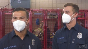 Two firefighters help deliver baby in parking lot