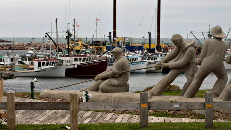 A sculpture shows fishermen pulling on a line in front of the marina, Monday, August 6, 2012 in L'Étang du Nord on the Magdalen Islands. THE CANADIAN PRESS/Jacques Boissinot