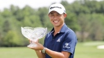 Collin Morikawa holds his trophy after winning the Workday Charity Open golf tournament, Sunday, July 12, 2020, in Dublin, Ohio. (AP Photo/Darron Cummings)