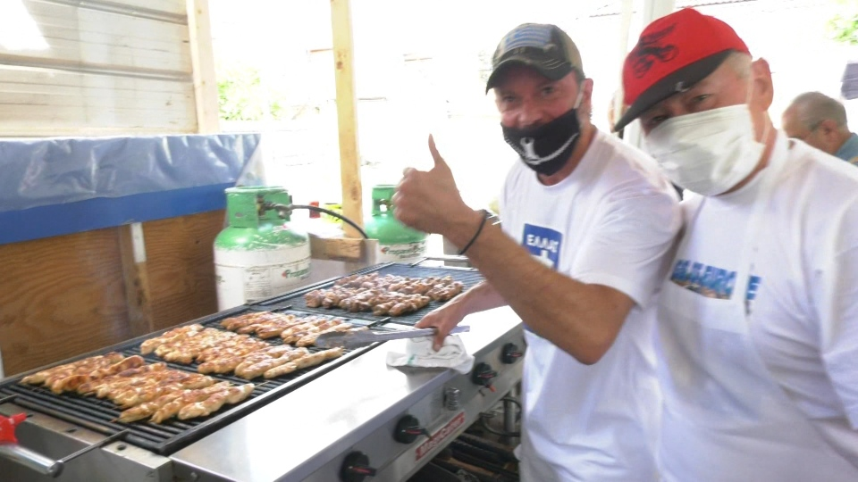 Men cook chicken souvlaki at Greek Summerfest on July 12, 2020.