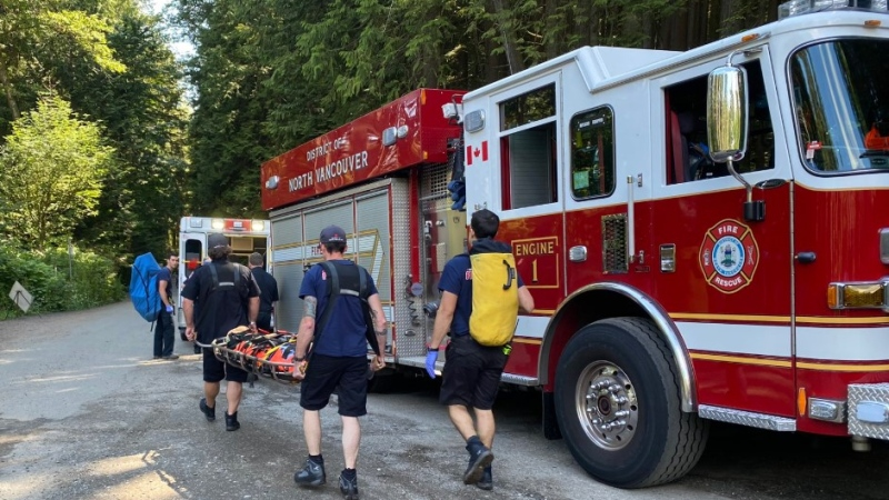 District of North Vancouver fire fighters rescue an 11-year-old mountain biker who was injured on Mt. Fromme July 12, 2020. (Twitter/DNVFRS)