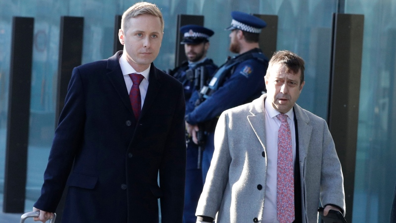 In this Aug. 15, 2019, file photo, Jonathan Hudson, left, and Shane Tait, defense lawyers for Brenton Tarrant, arrive at the Christchurch District Court in Christchurch, New Zealand. (AP Photo/Mark Baker, File)
