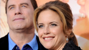 "A March 25, 2010, file photo shows Kelly Preston, right, a cast member in ""The Last Song,"" with her husband John Travolta at the premiere of the film in Los Angeles. (AP Photo/Chris Pizzello, File)"