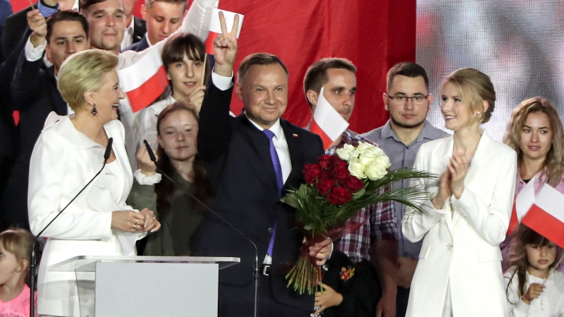 Incumbent President Andrzej Duda flashes a victory sign in Pultusk, Poland, Sunday, July 12, 2020. (AP Photo/Czarek Sokolowski)