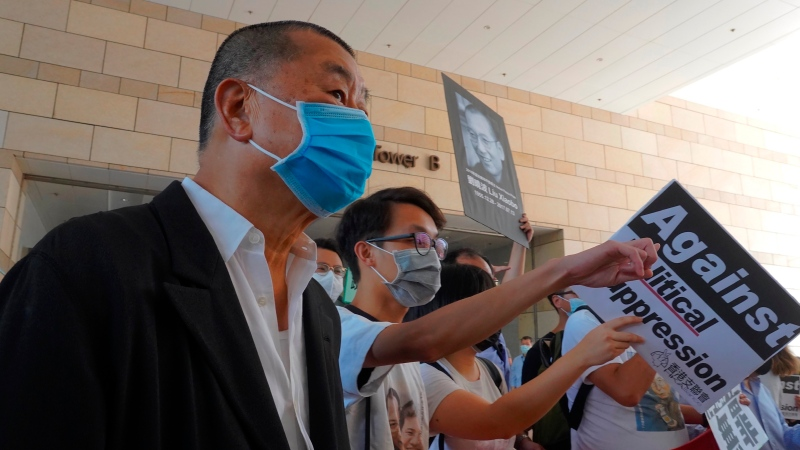 Hong Kong media tycoon Jimmy Lai, founder of the local newspaper Apple Daily, arrives outside a district court in Hong Kong, Monday, July 13, 2020. (AP Photo/Vincent Yu)