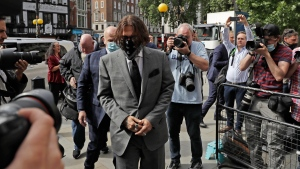 American actor Johnny Depp arrives at the High Court in London, Monday, July 13, 2020. (AP Photo/Matt Dunham)