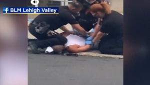 Warning, graphic video: An officer is seen with his knee on a man's neck during an arrest in Allentown, Pa.