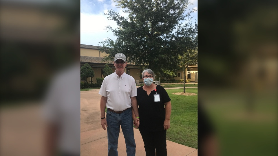 Mary Daniel says her husband Steve still recognizes her, even when she's wearing a mask. (Courtesy Mary Daniel/CNN)