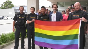 The rainbow flag is raised outside London police headquarters in London, Ont. in July 2019.