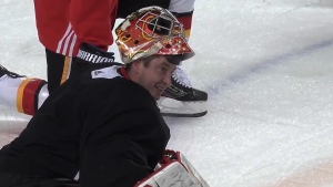 Flames goaltender David Rittich on the Saddledome ice (Twitter/ @NHLFlames)