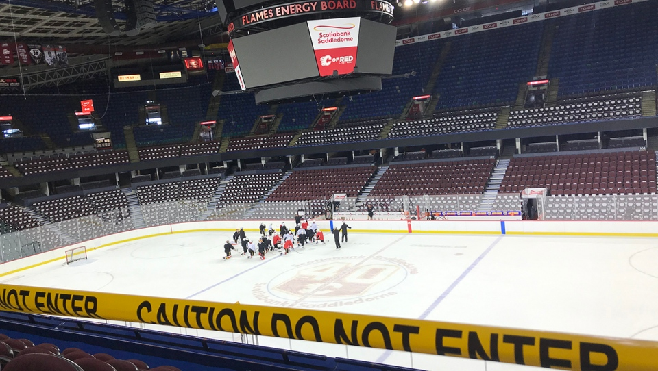 Members of the Calgary Flames take part in the first of two divided practices at the Scotiabank Saddledome, the team's first since the NHL's COVID-19 related stoppage