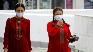 Women wearing masks in Turkmenistan, whose government insists the country is entirely coronavirus-free. (AFP)