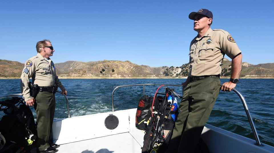 Sgt. Tim Lohman, left, and Capt. Jeremy Paris of the Ventura County Sheriff's Department, continue the search for missing actress Naya Rivera at Lake Piru, Friday, July 10, 2020, in Los Padres National Forest, Calif. (Photo/Chris Pizzello)