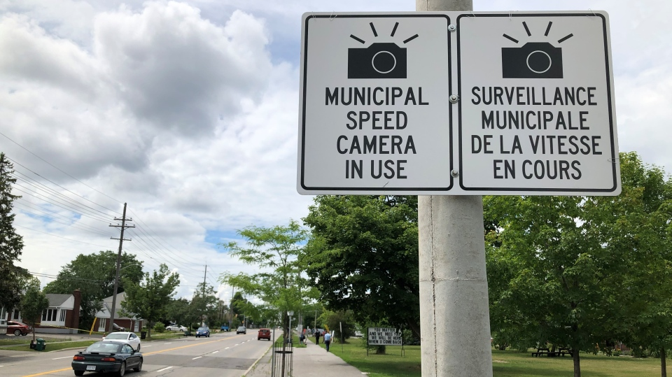 Signs warning drivers that photo radar cameras are ahead. (Dave Charbonneau / CTV News Ottawa)