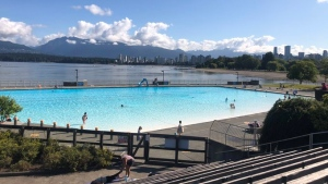 A few swimmers are seen at Kitsilano Pool on Monday, July 13, 2020 shortly after it reopened to the public.
