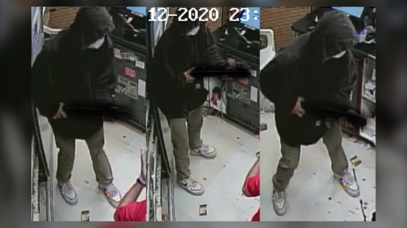 Surveillance images of a suspect wearing an N-95-style face mask during a July 12 armed robbery of a Circle K in High River (RCMP)
