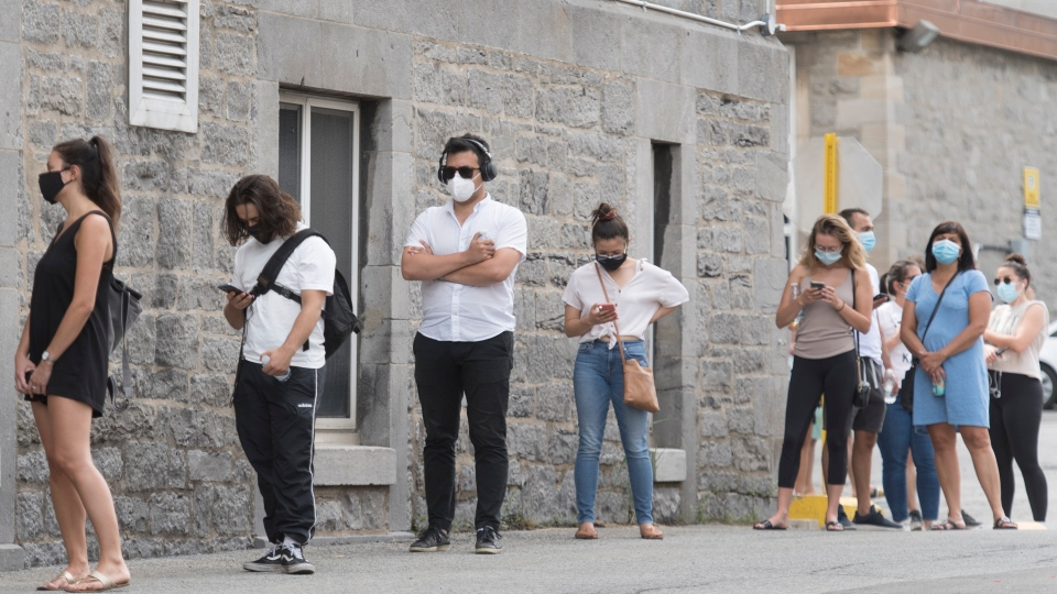 People wait to be tested for COVID-19 at a testing clinic in Montreal, Sunday, July 12, 2020, as the COVID-19 pandemic continues in Canada and around the world.THE CANADIAN PRESS/Graham Hughes