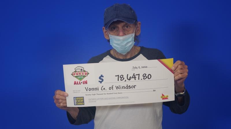 Vonni Genovesi of Windsor displays his Jackpot winning of $78,746.80 (Source: OLG)