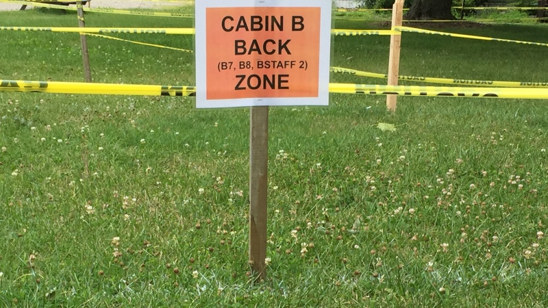 Yellow tape marks distances for those quarantining at Pearce Williams camp in Fingal, Ont. on Monday, July 13, 2020. (Bryan Bicknell / CTV News)