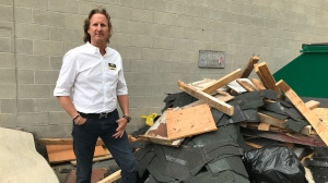 Scott Saunders, 400 Market, stands by a pile of debris that was illegally dumped on his property and it was all caught on tape. July 13, 2020. (Rob Cooper/CtV News)