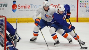 New York Islanders right wing Jordan Eberle, right, maneuvers the puck in front of left wing Michael Dal Colle during an NHL team hockey practice Monday, July 13, 2020, at the team's practice facility in East Meadow, N.Y. (AP Photo/Kathy Willens)