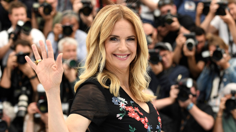 "In this May 15, 2018, file photo, actress Kelly Preston poses for photographers during a photo call for the film 'Gotti' at the 71st international film festival, Cannes, southern France. Actress Kelly Preston, whose credits included the films ""Twins"" and ""Jerry Maguire,"" died Sunday, July 12, 2020, her husband John Travolta said. She was 57.(Photo by Arthur Mola/Invision/AP, File)"