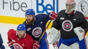 Montreal Canadiens defenceman Shea Weber, centre, defends against forward Tomas Tatar in front of goaltender Carey Price as they take part in their first team practice Monday, July 13, 2020 in Brossard, Que. THE CANADIAN PRESS/Ryan Remiorz