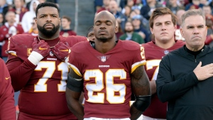 In this Dec. 22, 2018, file photo, Washington running back Adrian Peterson (26) stands for the national anthem before an NFL football game against the Tennessee Titans in Nashville, Tenn. (AP / Mark Zaleski, File)