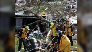 File photo: Rescue workers sifted through debris looking for survivors in Green Acres Campground 60 kilometres southeast of Red Deer Alta., Saturday, July 15, 2000, after a tornado touched down in the area Friday evening. (CP PHOTO/Adrian Wyld)