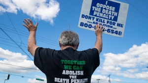 Protesters against the death penalty gather in Terre Haute, Ind., on July 13, 2020. (Michael Conroy / AP)