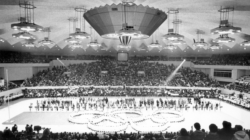 In this Feb. 13, 1972, file photo, Olympic rings in the center of the Makomanai ice arena is seen during the closing ceremony of the Winter Olympics, in Sapporo, Japan. (AP Photo)