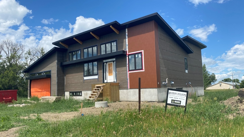 Jason Merkl says he paid Harmony Builders nearly $500,000 to build his late wife's dream home in Edgeley. The home sits unfinished. (Morgan Campbell / CTV News Regina)
