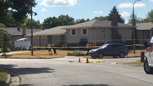 Police tape blocks an intersection where a pedestrian was reportedly hit by a vehicle. (Tegan Versolatto / CTV Kitchener)
