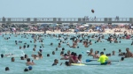 People enjoy a warm day at the beach in Miami Beach, Florida, USA, 12 July 2020. Florida reports 15,300 new Coronavirus cases, a record for one day anywhere in the U.S. (Cristobal Herrera/EPA-EFE/Shutterstock)