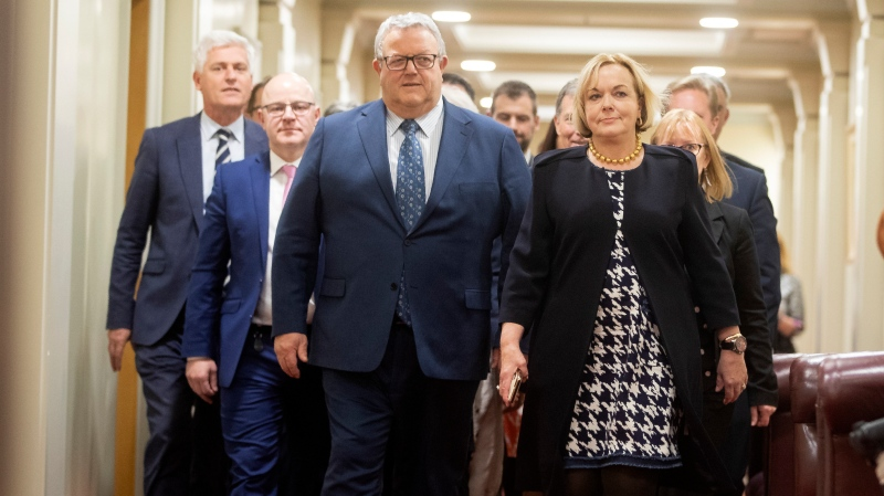 New leader of the New Zealand opposition National Party, Judith Collins, right, walks with new deputy leader Gerry Brownlee, as they emerge from the party room vote at parliament in Wellington, New Zealand, July 14, 2020. (Robert Kitchin/Pool Photo via AP)