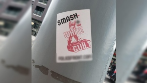 Several photos of these stickers were shared on social media over the weekend after they were reportedly seen around Kitchener. (@smoestoe / Twitter)