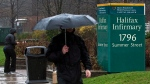 An unidentified man heads past the Halifax Infirmary in Halifax on Tuesday, April 24, 2012. (THE CANADIAN PRESS/Andrew Vaughan)