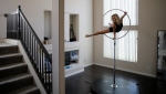 "Melissa James, a dancer and aerialist in the show ""Extravaganza"" at Bally's casino resort, trains in her home Saturday, June 20, 2020, in Las Vegas. ""I do something every day,"" said James about training while her show is closed due to the coronavirus. (AP Photo/John Locher)"