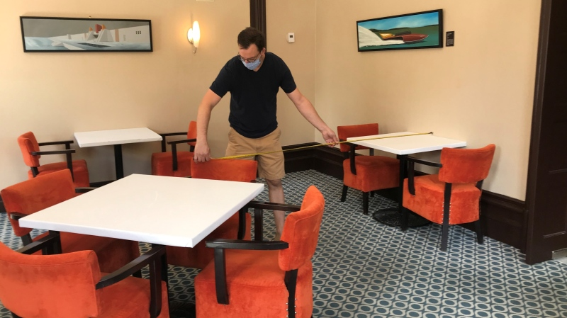 Stephen Beckta, owner of Beckta Dining & Wine, prepares his dining room for customers on July 14, 2020. Indoor dining will be allowed in Ottawa as of Friday, July 17, 2020. (Leah Larocque / CTV News Ottawa)