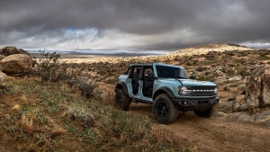 The 2021 Ford Bronco seen here with the Sasquatch off-road package and its roof and doors taken off.